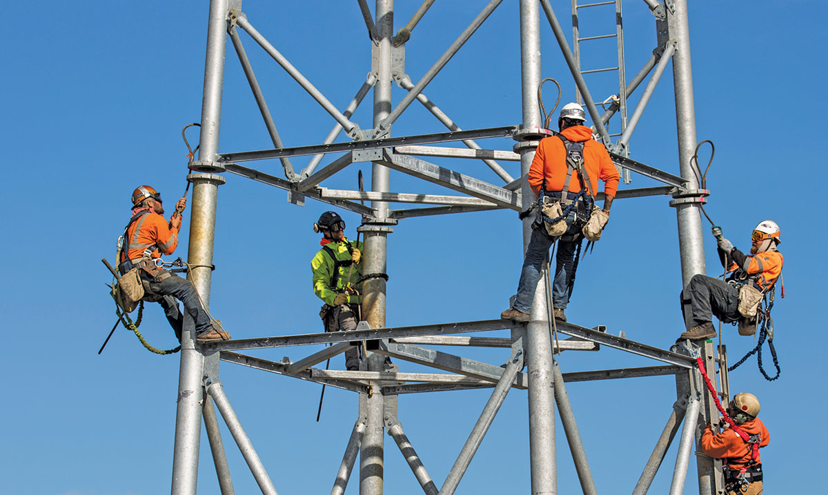 Workers working on cell tower equipment near Kotzebue