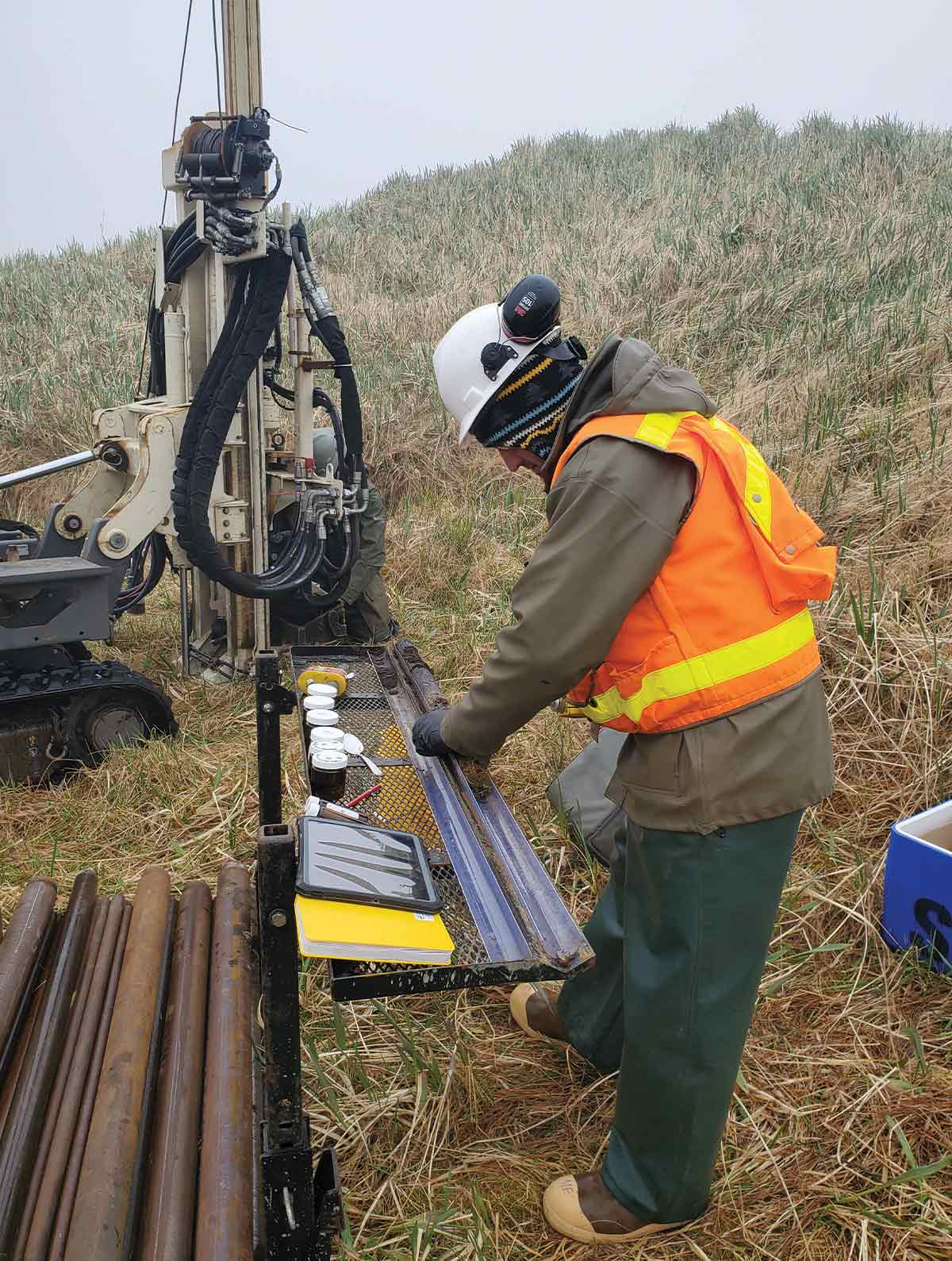 Ahtna field geologist Mike Ebert collects soil samples.